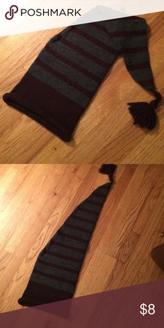 """Striped Hat Dark purple and gray striped long winter hat. Fun Pom Pom tassel on end. Perfect for kids!Measures 27"""". Never worn. No brand but I'm pretty sure I bought it from Old Navy. Perfect condition. Price is firm unless bundle. Old Navy Accessories Hats"""