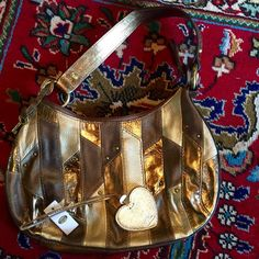 ✨METALLIC BROWN & GOLD STUD DETAIL FOSSIL HOBO BAG BOHO CHIC READY IN EXCELLENT CONDITION PERFECT HOBO BAG FOR EVERYDAY MATCHES ANYTHING SO GLAD METALLICS ARE IN FASHION CANT GET ENOUGH OF THE BLING Fossil Bags Shoulder Bags
