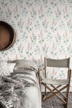 Pretty Sandberg wallpaper design, featuring delicate repeated motifs of meadow flowers.