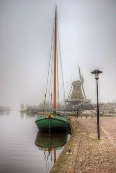 Boat and Windmill on a Misty Day Friesland Netherlands Photography by klaash63