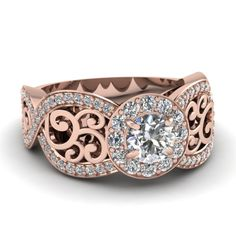 #fascinating #diamonds #halo #engagementrings #engagement #rings #rose #gold #round #cut #white #side #stone #wedding #jewelry by Fascinating Diamonds
