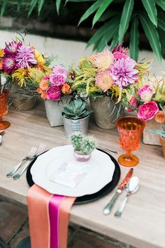 Papaya shantung napkin paired with cerise napkin for a double napkin look. Day of the Dead Inspiration planned by Two Be Wed. Colorful floral by Flower Power Productions at Las Velas Venue in Houston, Texas