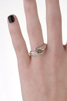 Close up shot of the variety colored center stones and diamond ring