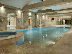 Need indoor swimming pool ideas? Check out out massive photo gallery showcasing 52 cool indoor swimming pool designs. Hidden Swimming Pools, Hidden Pool, Luxury Swimming Pools, Luxury Pools, Dream Pools, Swimming Pool Designs, Lap Swimming, Small Pools, Small Backyards
