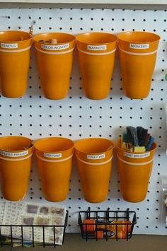 Small Fry & Co.: Do it Yourself Art Center for Kids - use zip ties to attach cups to the peg board