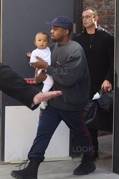 Kanye West wearing Champion Vintage Logo Script Sweatshirt, Brain Dead Mohair Snapback Cap Hat, Yeezy Season 3 Boots