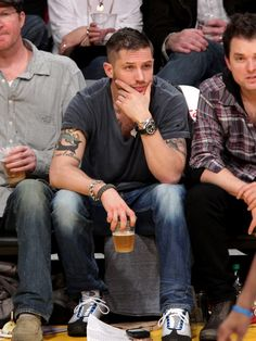 Tom Hardy might wear goofy shoes, but he's got a dreamy voice and a beer, so all is forgiven