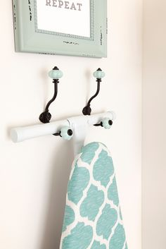 Coat Hooks to hold Ironing Board -- DIY Laundry Room Storage Center (Home Depot)