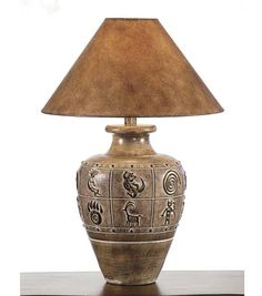 Desert Collection Lamp 236SB Western Lamps - From our Made in the USA Desert Collection. Detailed design of Southwestern rock art images on hand finished aged sand base.