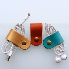 Earbud / earphone / cable organizers in gold , turquoise and rust vegetable tanned leather by RinartsAtelier
