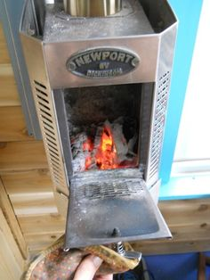 Newpport brand woodstove for a Tiny Home. It keeps a small space warm even in Vermont winters. Might work for SD winters too. You could just about afford split wood for it for the winter. :) might even be able to heat a small pot of water on it Tyni House, Tiny House Living, Small Living, Micro House, Wood Burner, Tiny Spaces, Maker, Little Houses, House Plans