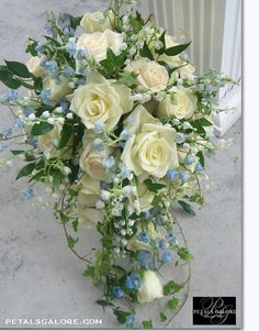 another cascade bouquet. not sure what the blue flowers are?