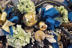 Royal Blue Centerpiece Beneva Flowers is proud to be the house florist of the Ritz- Carlton: Sarasota. This year's Christmas decor featured gold, navy and green. #Sarasota