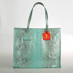 """Refined woman python shopper in the wonderful Limpet Shell color, a very fresh and dynamic tonality further enlightened by the particular working process python leather has been submitted to in order to assume a silky aspect.  ITEM: 5045 MANUFACTURE: 100% Made in Italy. Genuine Italian Craftsmanship.  MEASURES: cm. 39x34x10 ( 15.35""""x 13.38""""x 3.93"""") OUTSIDE COMPOSITION: Genuine Reticulatus python. Scientific name: Python Reticulatus. LINING: Beige fabric with python finishing. HANDLES: Two…"""