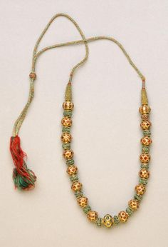 Gold, rubies, emeralds, silk and gold thread, Made in India, Asia Possibly made in Karnataka, India, Asia Possibly made in Tamil Nadu, India, Asia. 18th - 19th century. Philadelphia Museum of Art.
