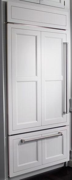 Paneled refrigerator with bottom drawer freezer