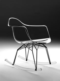 Diamond Rocker Chair  Polycarbonate Armshell in clear transparent, smoke, black or white. Chromium-plated white or black powder-coated base, acrylic or solid walnut legs.