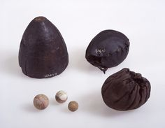 Toys of wood and leather from medieval Bergen. Includes a spinning top, marbles, and two balls. Photograph by Svein Skare, Universitetsmuseet i Bergen.
