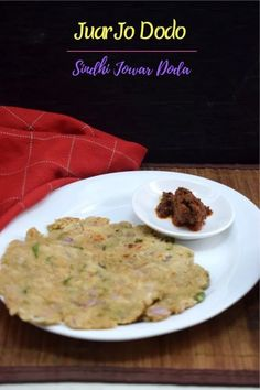 Juar Jo Dodo is a sindhi style Indian Flatbread made with Jowar or Sorghum flour along with green chilies, coriander leaves and green garlic. Fresh Coriander, Sorghum Flour, Millet Recipes, Rustic Bread, Indian Breakfast, Vegetable Side Dishes, How To Make Bread, Different Recipes, Kitchens