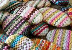 """Cute """"Easter Egg"""" brooches from the homemade weaving loom."""