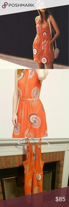 Sale 🎉 Anthro Halter Dress Beautiful orange color and print, this dress is fun and flirty! NWT, never worn. TTS 4. Would fit a small. There are also pockets and the neck ties in back making it adjustable. Elastic wasteband at wasteline. Anthropologie Dresses