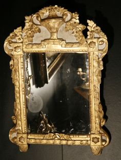 Small mirror #LouisXVI in #giltwood, #carved with an urn on the pediment and embellished with ovals on the moldings. 18th century. For sale on #Proantic by Olivier Camus Antiquités.
