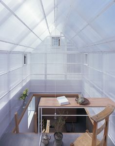House in Yamasaki.  Top of house is covered by a double layer of translucent polycarbonate sheets, inspired by greenhouses.
