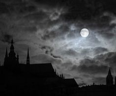 Light; Eerie: strange and scary. The bright moonlight cast through dark clouds with the silhouette of an old scary castle gives off an eerie feeling.