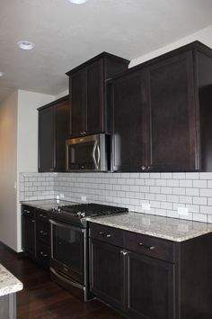 Dark Cabinets White Subway Tile Backsplash And Revere