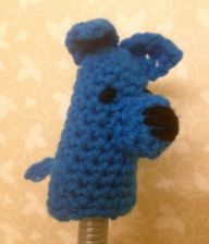 We met the lady who makes these and leaves them in caches... she's really sweet!   Blue dog crocheted finger puppet