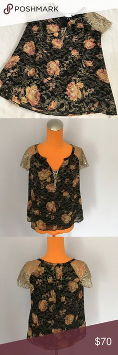 """HD in Paris Black/Gold Lace Sleeve Floral Blouse 24"""" length 17.5"""" armpit to armpit. Gold lace sleeves. Lace insert in chest area. Black and gold floral pattern. Silk blended top. Excellent condition. Bundle 2+ items for a discount Anthropologie Tops Blouses"""