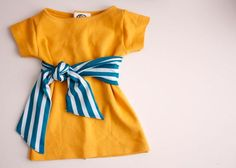 Simple Baby Shift Dress (adorable t-shirt transformation idea!) http://www.deliacreates.com/2012/02/nesting-simple-baby-shift-dress.html