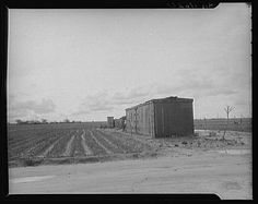 """Freight car converted into house in """"Little Oklahoma,"""" California. February, 1936. Photographer: Dorothea Lange"""