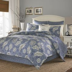 A cool blue and white floral pattern reverses to a blue leaf pattern to form the charming Avignon comforter set. Crafted with pure cotton sateen, this plush, woven comforter is accented with matching shams and a bedskirt to complete your bedroom.