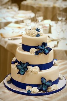 I love the blue orchids and white roses on this!