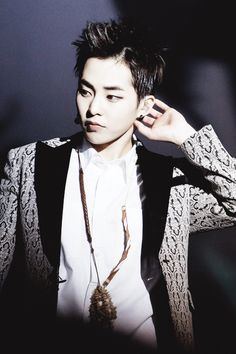 Xiumin, are you wearing a pinecone as a necklace? XD #Minseok