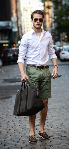 White button down shirt, hunter green short, leather belt, and large messenger bag