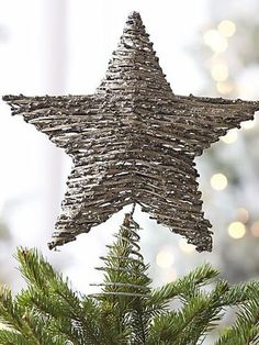 11 Cool and Creative Christmas Tree Toppers---shown is Crate & Barrel rattan star dipped in glitter. Lovely~