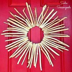 Welcome summer on your front door with a gorgeous, DIY driftwood sunburst wreath! Easy to make with these detailed instructions.