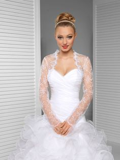 Chic and feminine, this embroidered tulle bolero is the perfect coverage option for your special day!  Available in all sizes (XS-6XL) and both in