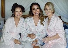 Homebodii Real Bride bridal party. Bride is wearing our Sofia Lilac Robe with lace trim and sleeves. Bridesmaid and Mother of the bride is wearing Homebodii's Ballet Beautiful Robe.