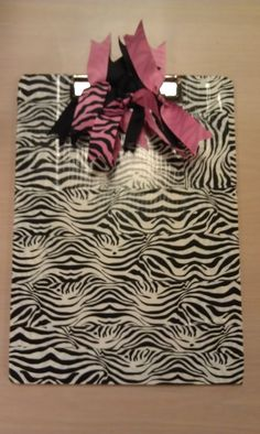 I did this to one of my old thirty-one clip boards! It matches my things at school and of course it is HIGH QUALITY clip board. It has a J on the back in hot pink.