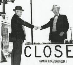 Shuichi Yamamoto, last evacuee to leave Amache, says 'Goodbye' to Director James G. Lindley as the Amache camp is officially closed, October 15, 1945. Project Director Lindley made the following statements in his final report dated November 15, 1945: 'A paragraph is necessary to express my feeling toward the evacuees. I have a lasting and deep regard for them. It is hard for one to visualize any other group of people who would be so well behaved under similar conditions. In close contact…
