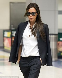 Picture perfect: The 40-year-old wore a complementary covering of bronze cosmetics, while she donned large black sunglasses over her eyes and wore her long brunette tresses down in a sleek style over one shoulder