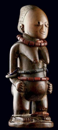 Africa | Ibeji (twin figure) from the Yoruba people of Nigeria | Wood, glass beads and fiber | Early 20th century