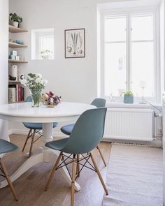 cute white bright dining room with Ikea round table blue chairs turquoise small . - - cute white bright dining room with Ikea round table blue chairs turquoise small . Ikea Round Table, White Round Dining Table, Dining Table Chairs, Ikea Dining Room, Eames Chairs, Upholstered Chairs, Room Chairs, Table Furniture, Furniture Ideas