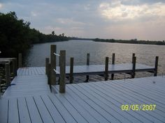 "Composite Walkway with pilings | 20' with 8' x 30' dock, ""Wood-Rx"" deck stain in ""Weathered Gray"""