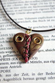 Broken heart steampunk necklace polymer clay pendant. €22,00, via Etsy.