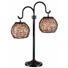 Twin rounded lanterns shine suspended from graceful curved arms. Gardner's woven shade design is artful and tactile with a Mediterranean flavor.  Indoor/outdoor