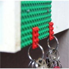 Lego Key Holder. Come home and snap them on. LOVE THIS IDEA!